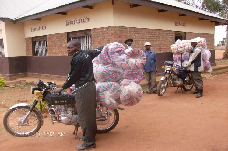Mattresses are delivered by motorcycle to Avari Health Centre.