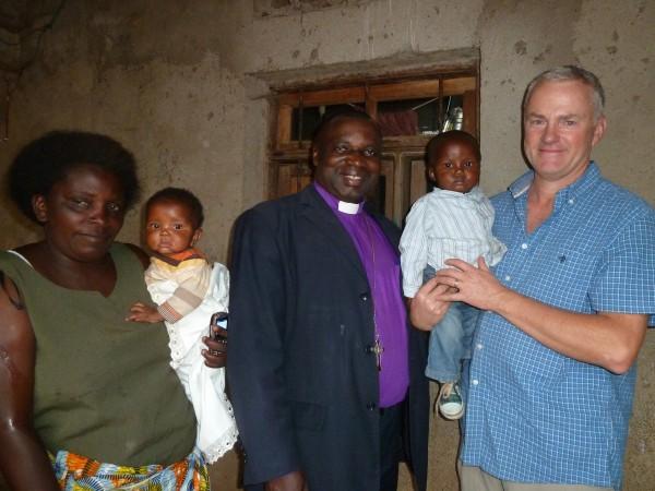 Baby Peter Isesomo between Bishop Isesomo and Peter Pearson