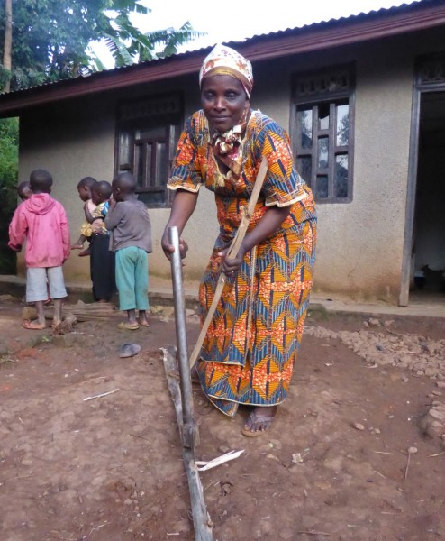 Madame Mbambu chopping wood